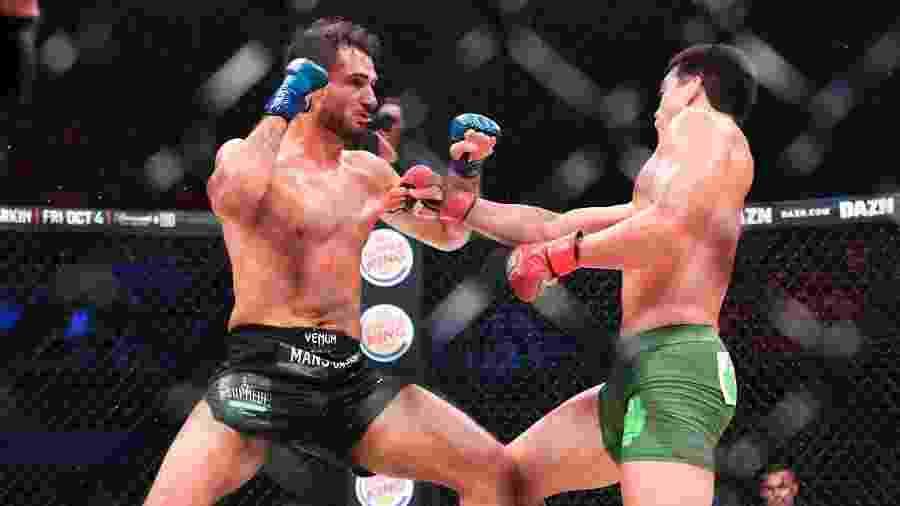 Gegard Mousasi (esq.), durante luta contra Lyoto Machida - Divulgação