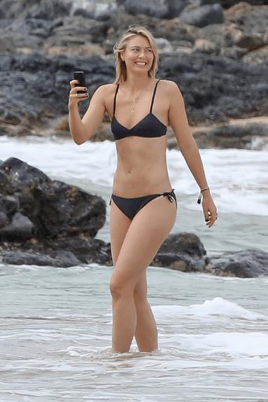 Suspensa das quadras, Sharapova aproveita tempo livre no Havaí