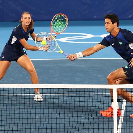 Luisa Stefani e Marcelo Melo durante duelo contra Djokovic e Stojanovic nas duplas mistas - Mike Segar/Reuters
