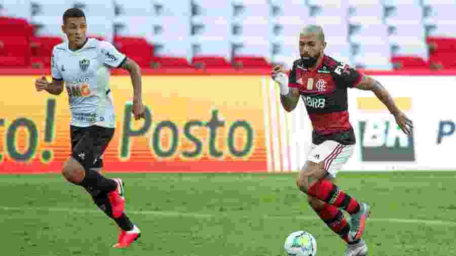 Gabigol, do Flamengo, marcado por Guilherme Arana, do Atlético-MG - Alexandre Vidal/Flamengo