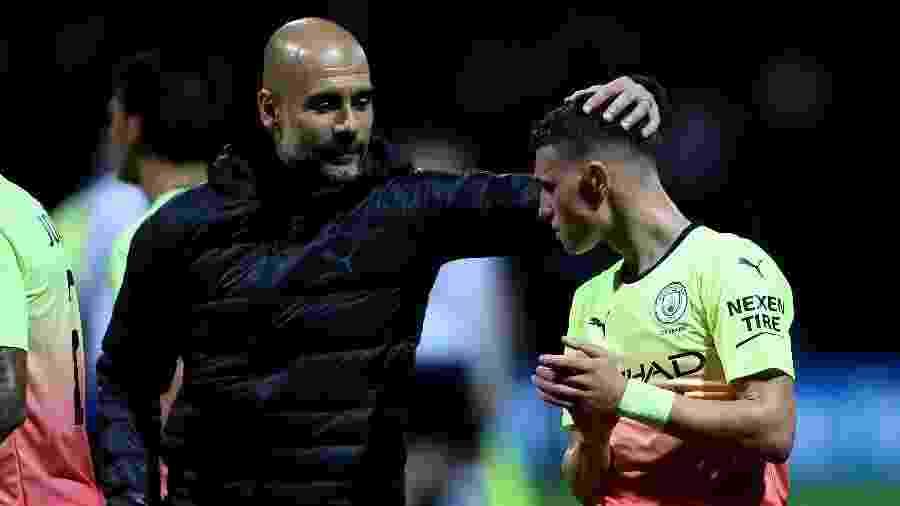 Guardiola e Phil Foden, em jogo do Manchester City - Richard Sellers/PA Images via Getty Images