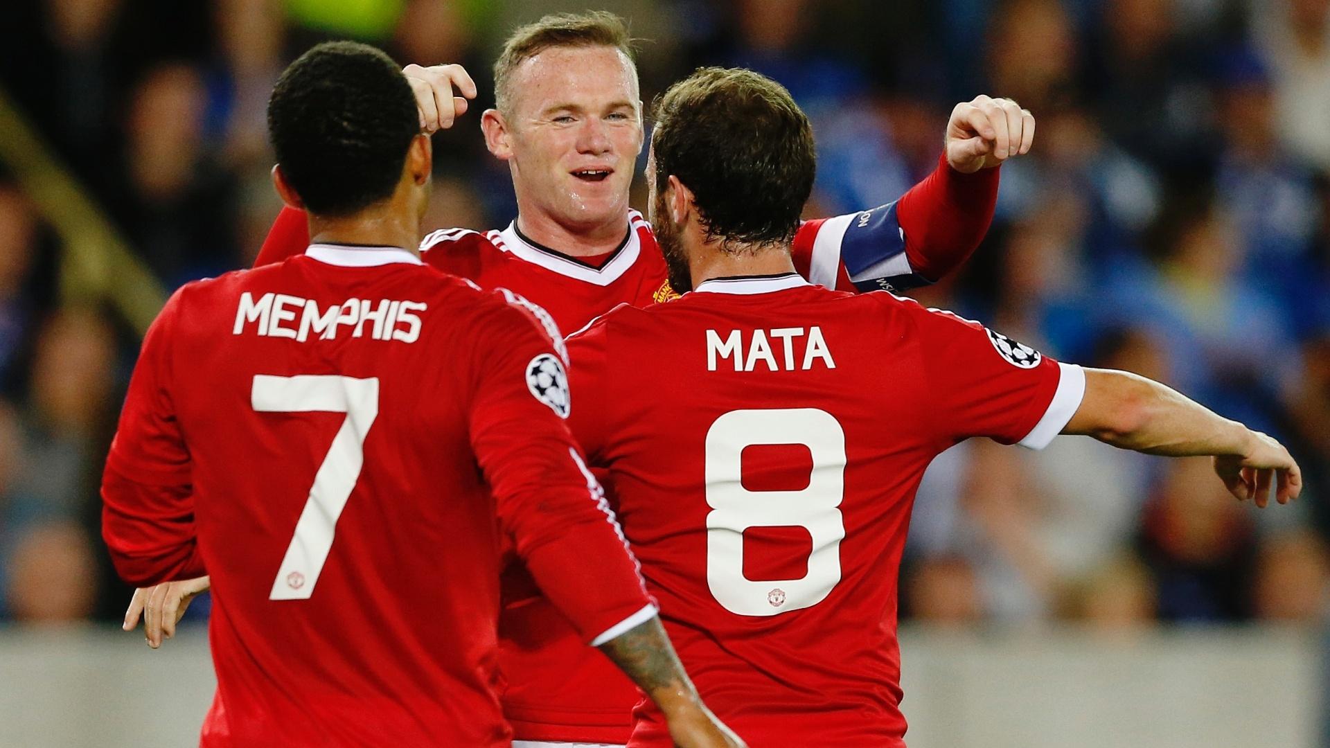 Rooney comemora um dos gols do Manchester United sobre o Club Brugge