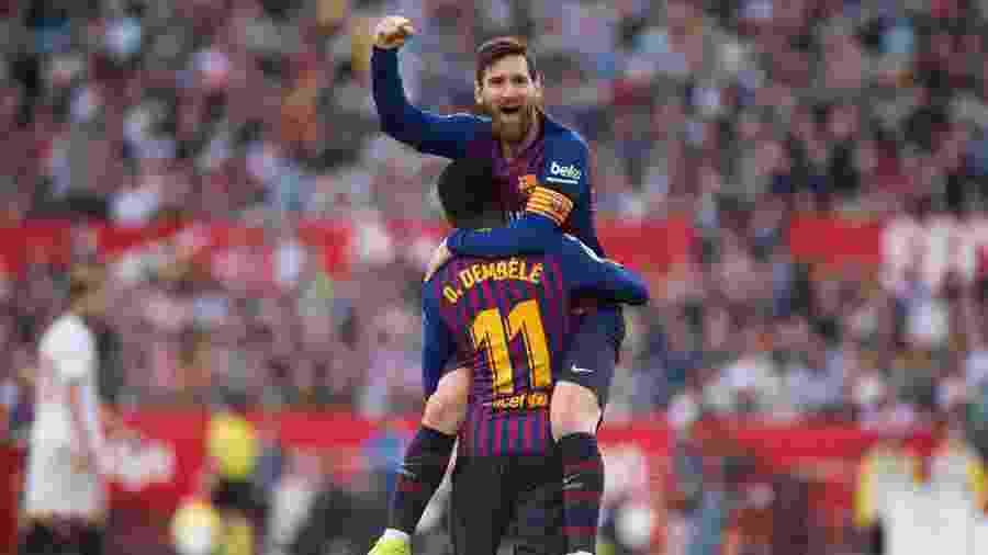 Messi fez três gols contra o Sevilla - JORGE GUERRERO / AFP