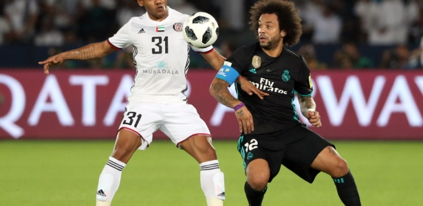 Time de Romarinho (esq) acabou punido pela Fifa nesta quinta-feira - Karim Sahib/AFP