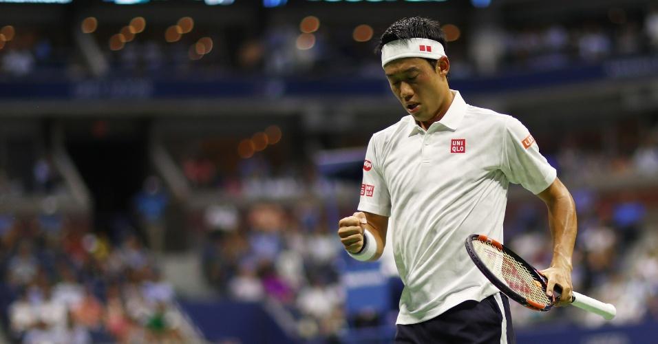Kei Nishikori comemora discretamente o ponto contra Stan Wawrinka no Aberto dos EUA