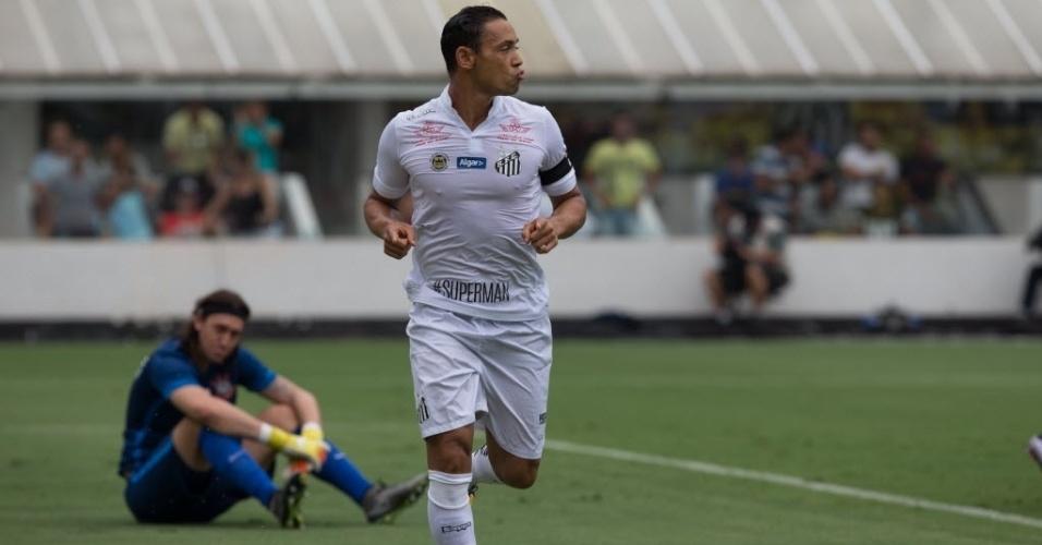 Ricardo Oliveira comemora gol contra o Corinthians, enquanto goleiro Cássio fica desolado no chão em clássico na Vila Belmiro