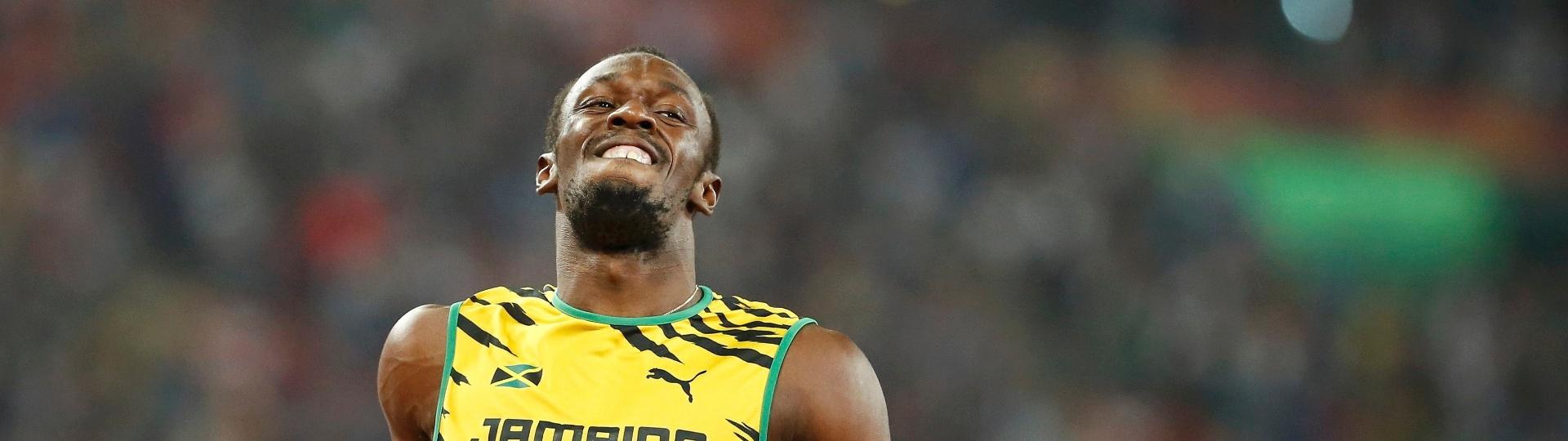 Usain Bolt sorri em chegada do revezamento 4x100m, em que a jamaica conseguiu ouro no Mundial