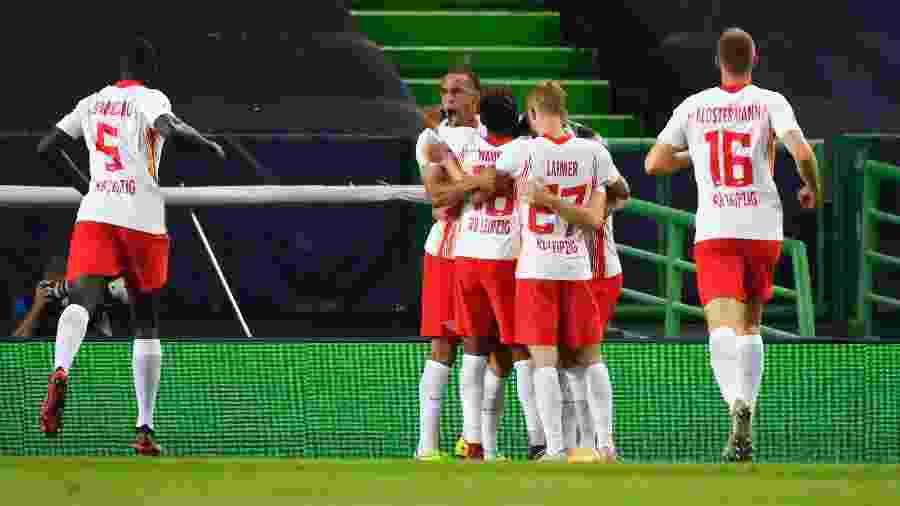 Jogadores do RB Leipzig comemoram gol sobre o Atlético de Madri nas quartas de final da Liga dos Campeões 2020 - Lluis Gene/Getty Images