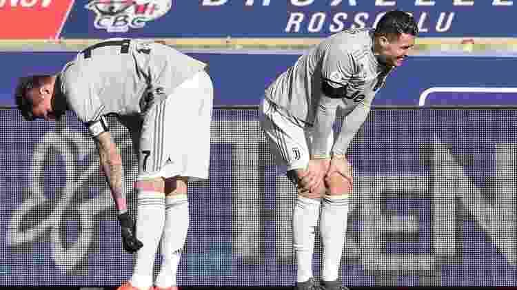 Cristiano Ronaldo e Mandzukic lamenta lance no jogo da Juventus - Tiziana FABI / AFP - Tiziana FABI / AFP