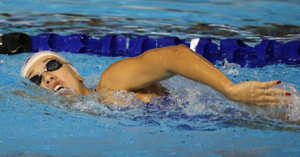 Brasileira Larissa Martins nada nas eliminatórias dos 100 m livre da natação. Ela fez o melhor tempo de sua bateria e avançou à final