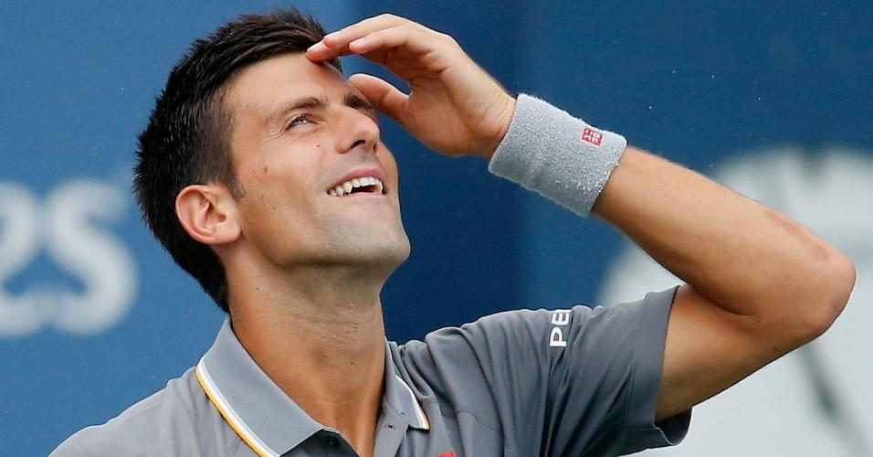 Djokovic sorri após boa jogada na partida contra Benoit Paire pelo Masters 1000 de Cincinnati