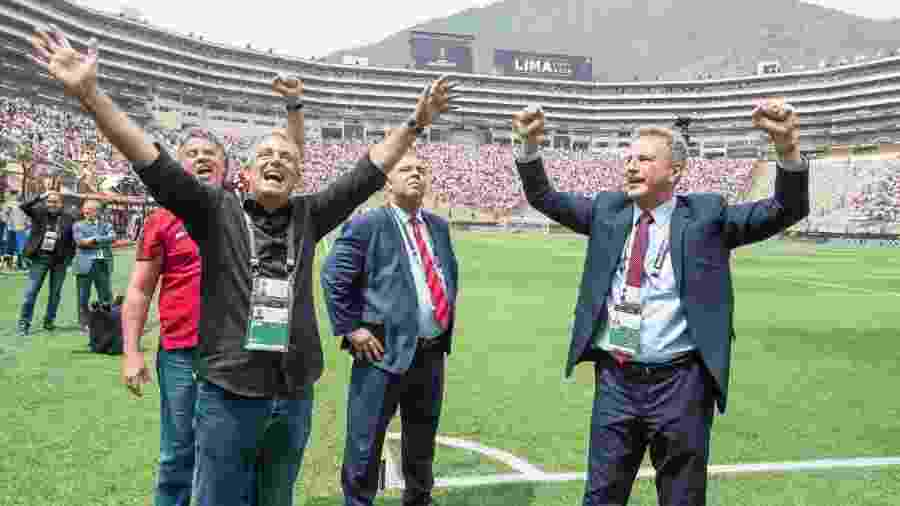 Bap, Marcos Braz e Landim celebram vitória do Flamengo na final da Libertadores - Foto: Alexandre Vidal / Flamengo