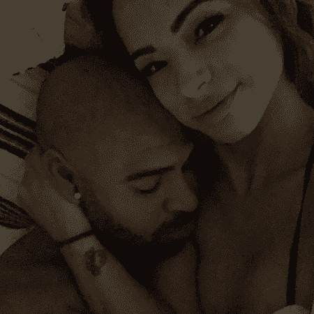 Adriano posa ao lado da namorada Hannah Alvares - Reprodução/Instagram