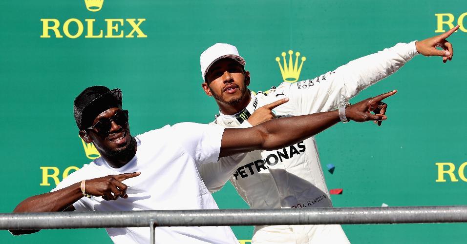 Usain Bolt e Lewis Hamilton no pódio do GP dos EUA