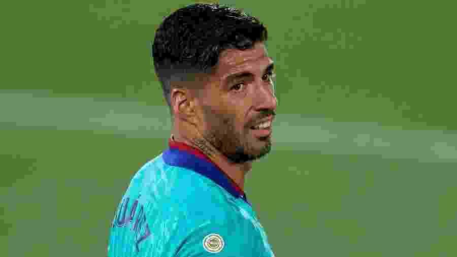 Luis Suárez etá perto de trocar o Barcelona pelo Atlético de Madri - Alex Caparros/Getty Images