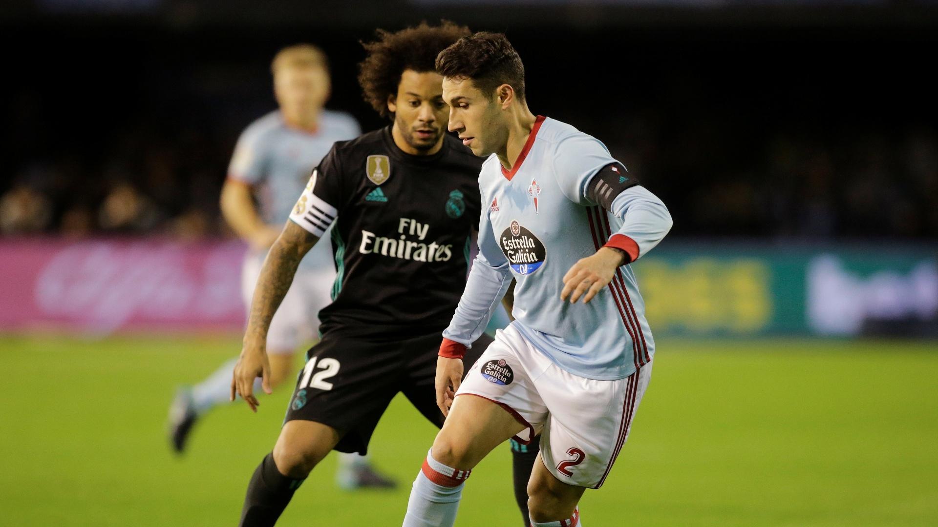 Marcelo disputando jogada na partida contra o Celta