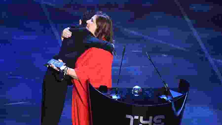 Silvia Grecco e o filho Nickollas venceram o prêmio Fifa Fan Award  - REUTERS/Flavio Lo Scalzo