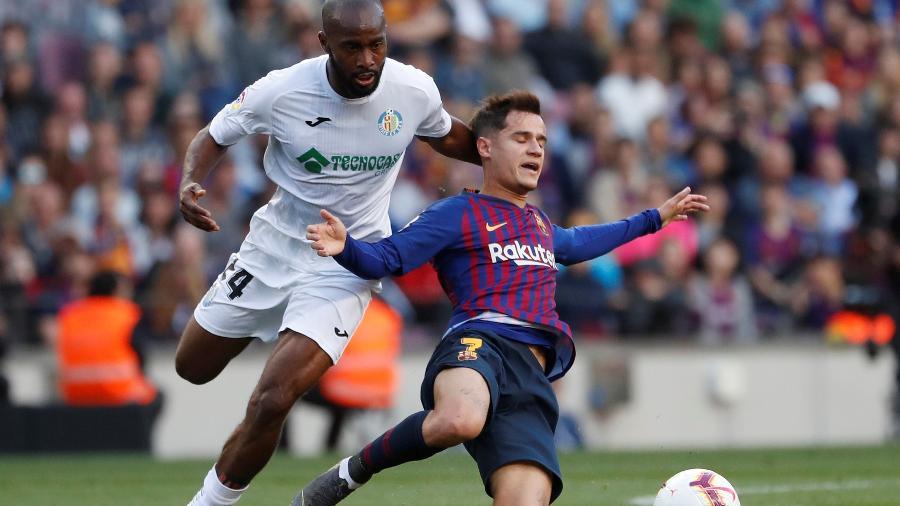Coutinho disputa lance com atleta do Getafe, pelo Espanhol; direitos de exibição são da Fox Sports - REUTERS/Susana Vera