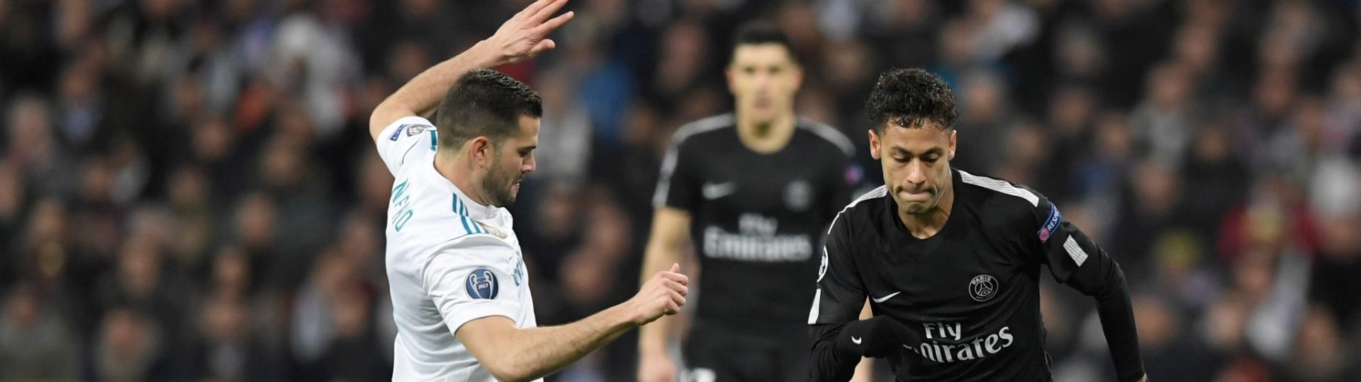 Neymar dribla Nacho na partida entre Real Madrid e PSG