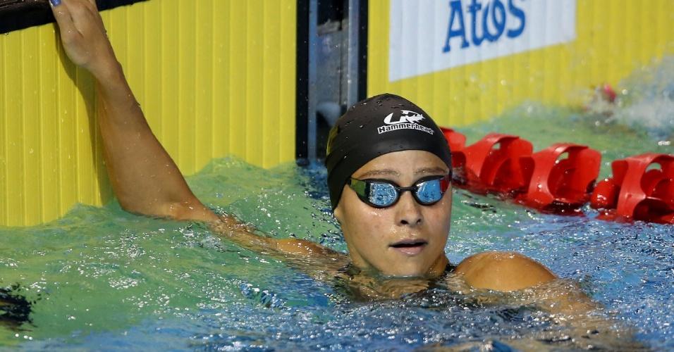 Daiene Dias confere seu tempo na bateria eliminatória dos 100m borboleta