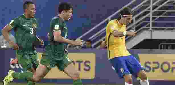 Forte na marcação, Filipe Luís foi bem no ataque e marcou um gol contra a Bolívia - AFP PHOTO / Nelson ALMEIDA