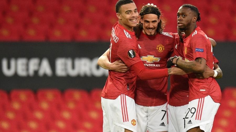 Jogadores do United comemoram o gol de Cavani sobre o Granada na Liga Europa - Oli SCARFF / AFP