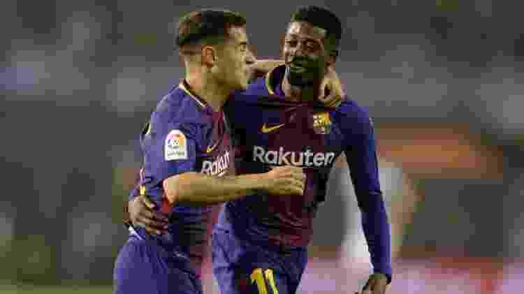 Dembélé comemora com Philippe Coutinho o gol do Barcelona diante do Celta - REUTERS/Miguel Vidal - REUTERS/Miguel Vidal