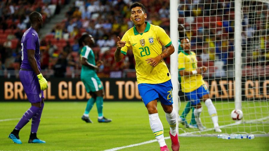 Firmino comemora gol da seleção brasileira sobre Senegal  - REUTERS/Feline Lim