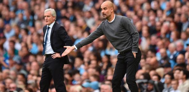 Guardiola é exigente com seus jogadores - Oli Scarff/AFP Photo
