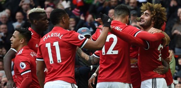 Jogadores do United comemoram gol da vitória sobre o Arsenal - AFP PHOTO / PAUL ELLIS
