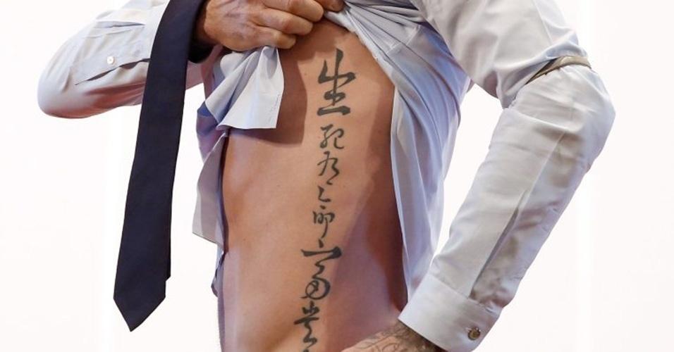 """5. DAVID BECKHAM - """"Vida e morte são determinadas pelo destino, enquanto posição social e riquezas são decretas pelo céu"""", diz, em tradução livre, a tatuagem feita em chinês, uma das muitas no corpo do ex-jogador inglês"""