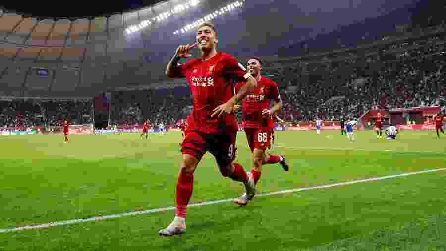 Roberto Firmino comemora gol do Liverpool contra o Monterrey - REUTERS/Kai Pfaffenbach