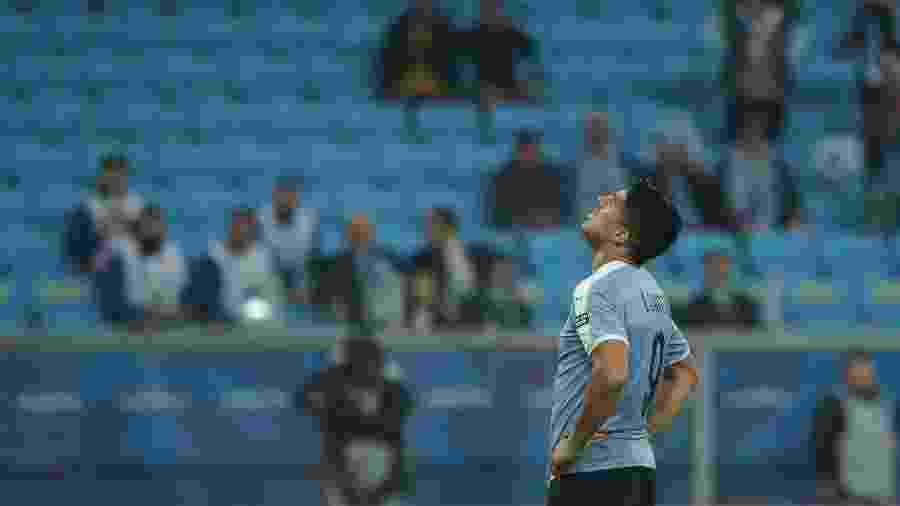 Luis Suárez lamenta chance desperdiçada em Uruguai x Japão: Arena Grêmio vazia - Guilherme Hahn/Agif