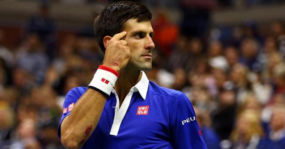 Novak Djokovic comemora ponto na final do Aberto dos EUA de 2015, contra Roger Federer