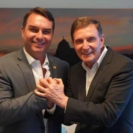 O senador Flávio Bolsonaro e o prefeito Marcelo Crivella, ambos do Republicanos - Divulgação