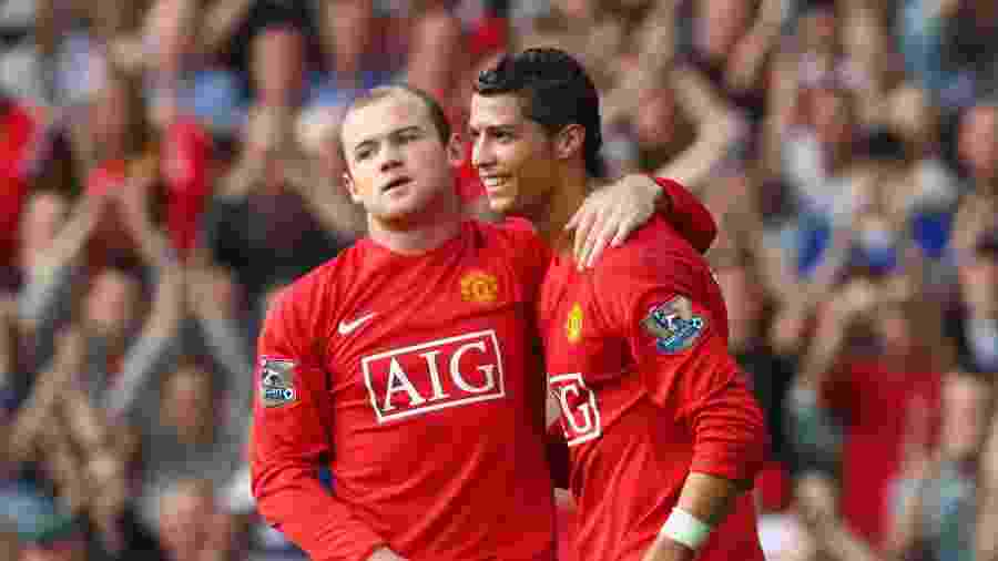 Cristiano Ronaldo e Wayne Rooney comemoram gol juntos nos tempos de Manchester United - Clive Brunskill/Getty Images
