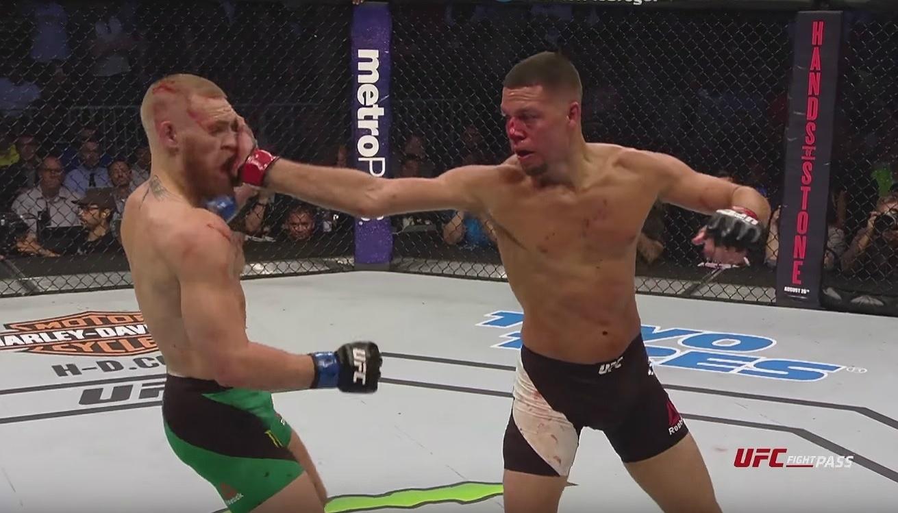 Nate Diaz dá um tapa na cara de Conor McGregor
