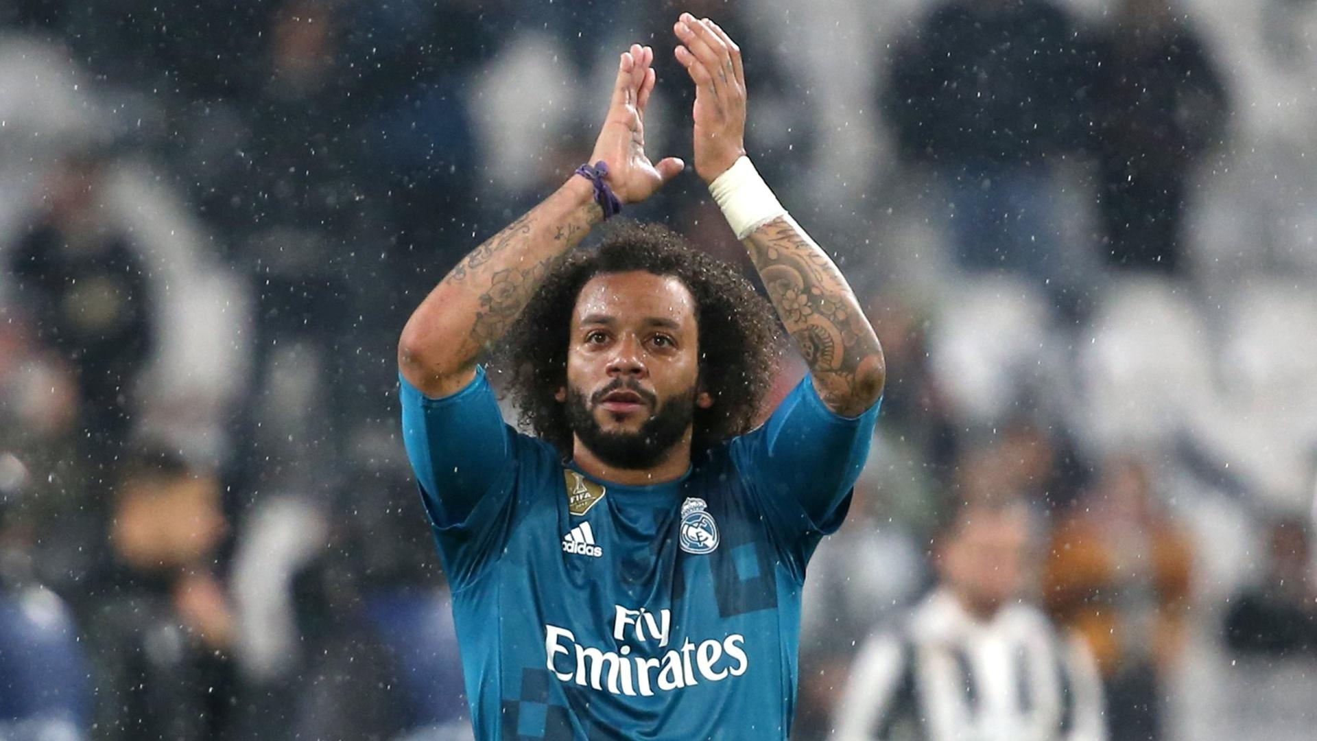 O lateral brasileiro Marcelo comemora vitória do Real Madrid sobre a Juventus em Turim