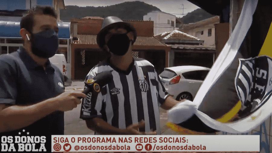 Neto compra bandeira do Santos ao vivo - Reprodução/Band