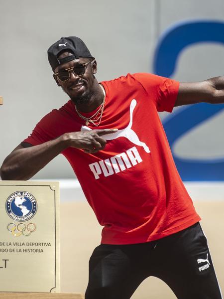 Usain Bolt participa de ação da Puma em Lima, no Peru - ERNESTO BENAVIDES/AFP