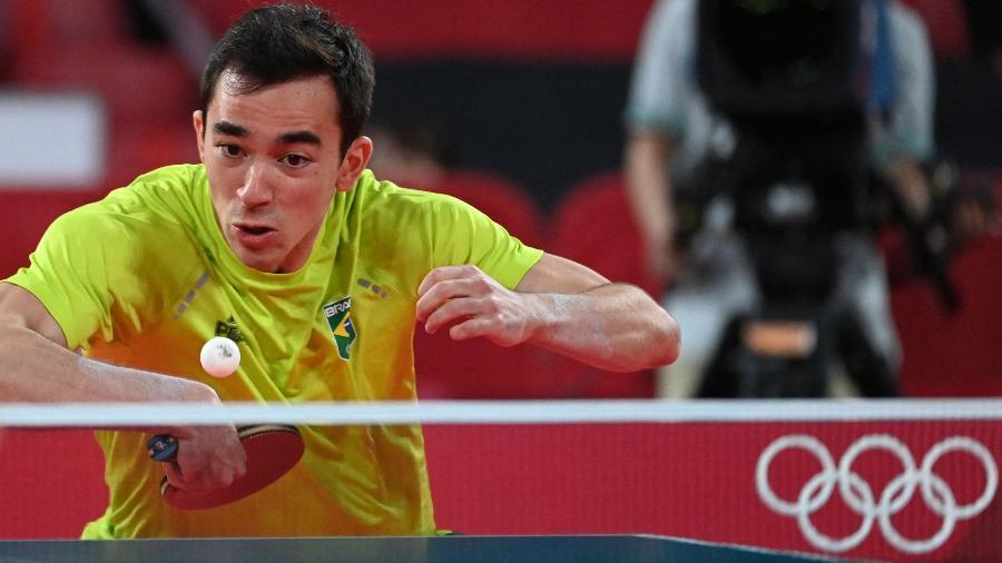 Hugo Calderano em ação pelo Brasil contra a Coreia do Sul no tênis de mesa - Adek Berry/AFP