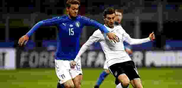 Daniele Rugani em ação durante jogo da Itália contra a Alemanha - Marco Bertorello/AFP