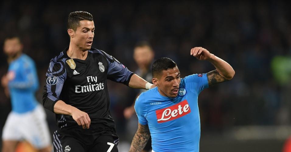 Brasileiro Allan marca Cristiano Ronaldo na derrota do Napoli por 3 a 1 para o Real pela Liga dos Campeões