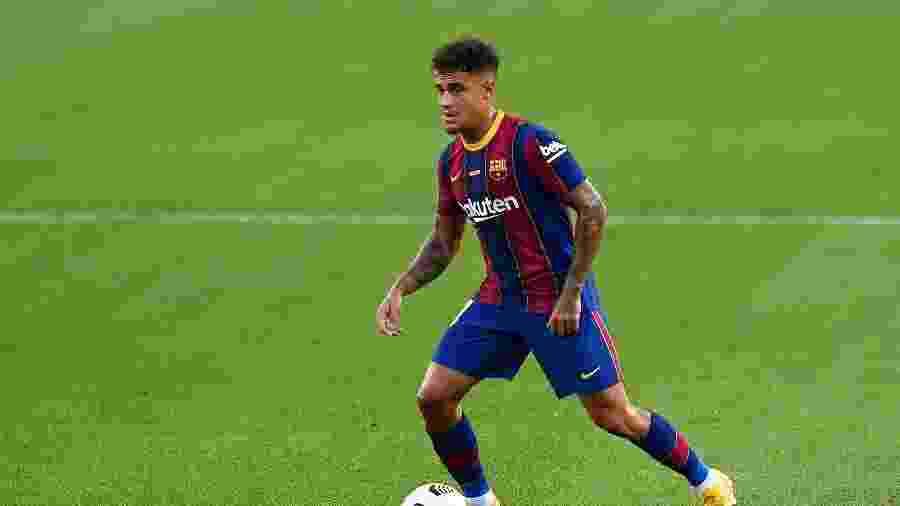 Philippe Coutinho, do Barcelona, atuando em amistoso contra o Elche; titularidade no começo de temporada - Josep LAGO/AFP