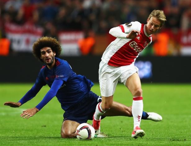 O holandês Frenkie De Jong passa por Fellaini durante a final da Liga Europa 2017/2018 - Dean Mouhtaropoulos/Getty Images