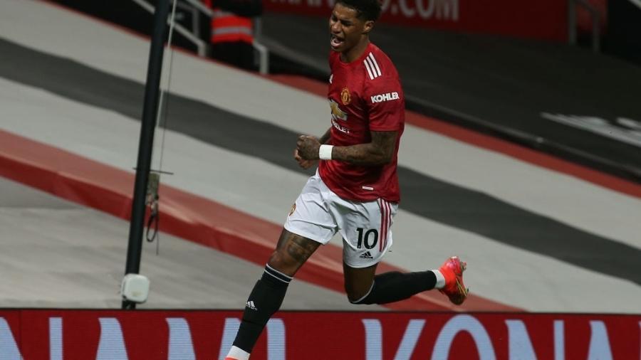Marcus Rashford celebra seu gol contra o Brighton pelo Campeonato Inglês - Matthew Peters/Manchester United via Getty Images