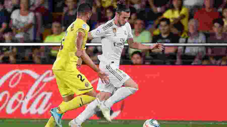 Gareth Bale, do Real Madrid, em lance com Mario Gaspar, do Villarreal - Josep LAGO / AFP