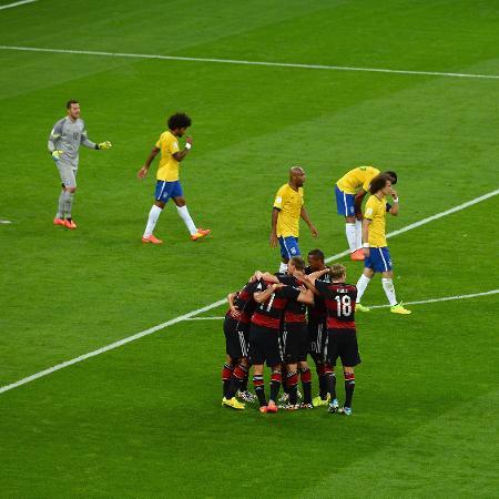 Seleção da Alemanha comemora um dos gols do 7 a 1 sobre o Brasil na Copa do Mundo de 2014 - Jamie McDonald/Getty Images