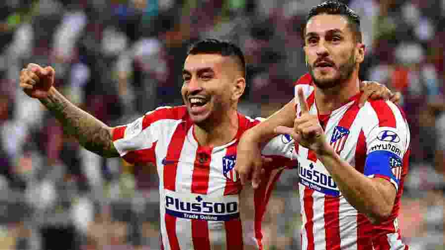 Koke (à direita) foi suspenso por acúmulo de cartões amarelos e não jogará contra o Barcelona - Giuseppe Cacace/AFP