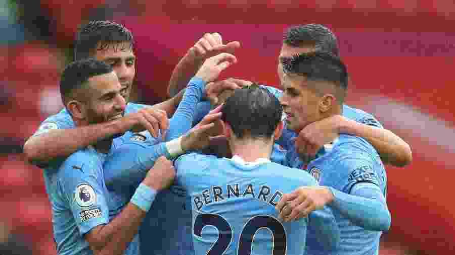 Jogadores do Manchester City comemoram gol de Kyle Walker contra o Sheffield United - Catherine Ivill/Reuters